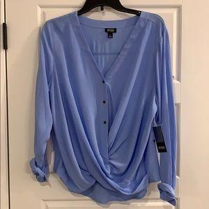 Women's blue long sleeve shirt.
